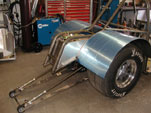 Side view of wheelie bars and trimmed tubs