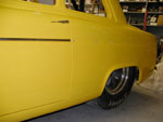 Buttons riveted on and front trim piece on the Anglia