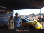 Standing by the Corvette Racing Team display